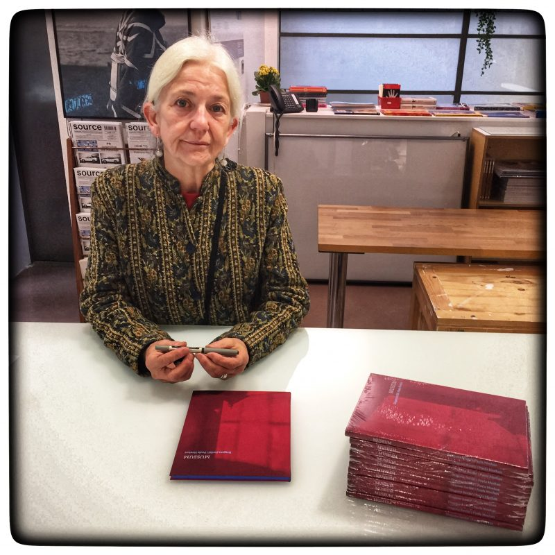 Poet Paula Meehan signing copies of MUSEUM in the Gallery of Photography Ireland