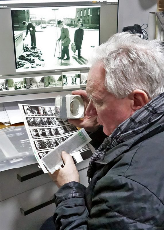 Tony O'Shea scanning his films at Gallery of Photography Ireland
