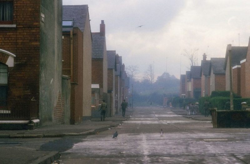 British soldiers foot patrol a Catholic area behind Falls Road, West Belfast, 1985, by Kaveh Kazemi
