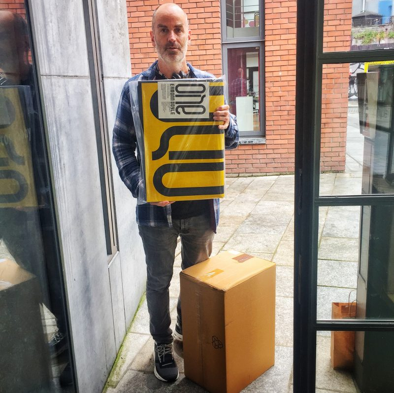 Photographer Eamonn Doyle delivering copies of ONE